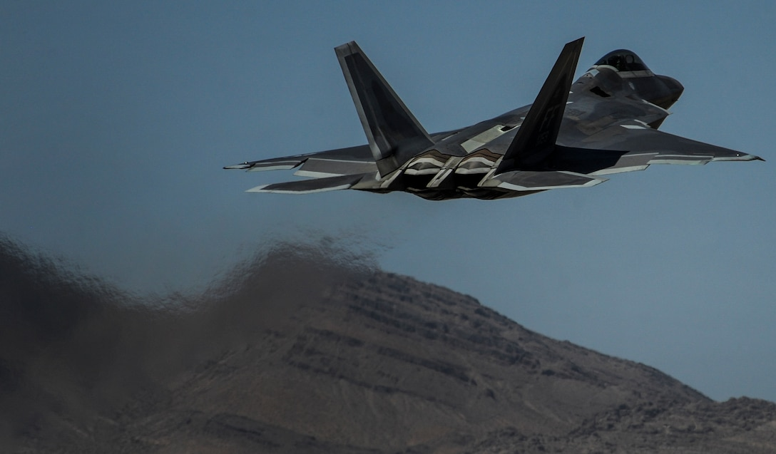 """An F-22A Raptor, assigned to the 27th Fighter Squadron, Joint Base Langley-Eustis, Va., takes off during the operations of Red Flag 16-3, July 11, 2016. Aircraft and personnel deploy to Nellis AFB for Red Flag under Air Expeditionary Force concept and make up the exercise's """"blue"""" forces. (U.S. Air Force photo by Airman 1st Class Kevin Tanenbaum/Released)"""