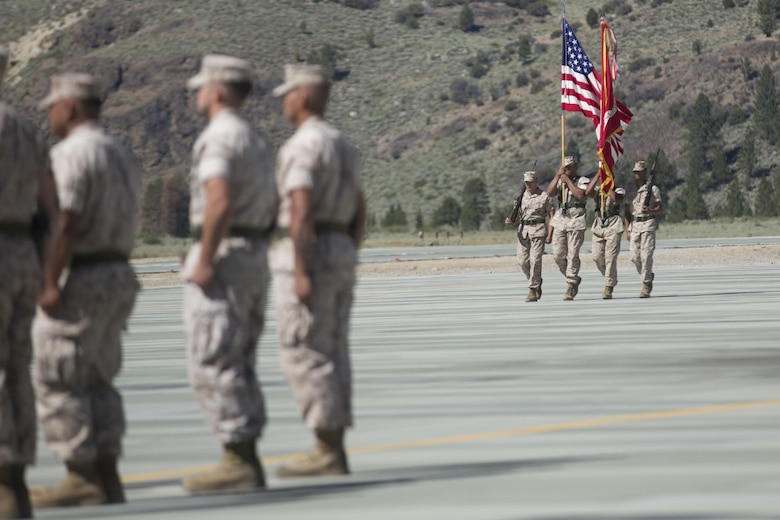 The Marine Corps Mountain Warfare Training Center Color Guard marches on the colors during the MCMWTC's change of command ceremony at the expeditionary airfield, July 22, 2016. During the ceremony, Col. Scott D. Leonard, outgoing commanding officer, MCMWTC, relinquished command to Col. James E. Donnellan, oncoming commanding officer, MCMWTC. (Official Marine Corps photo by Cpl. Medina Ayala-Lo/Released)