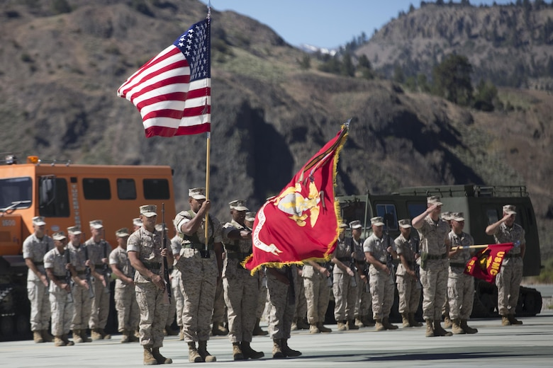 The Marine Corps Mountain Warfare Training Center Color Guard presents the colors during the MCMWTC's change of command ceremony at the expeditionary airfield, July 22, 2016. During the ceremony, Col. Scott D. Leonard, outgoing commanding officer, MCMWTC, relinquished command to Col. James E. Donnellan, oncoming commanding officer, MCMWTC. (Official Marine Corps photo by Cpl. Medina Ayala-Lo/Released)