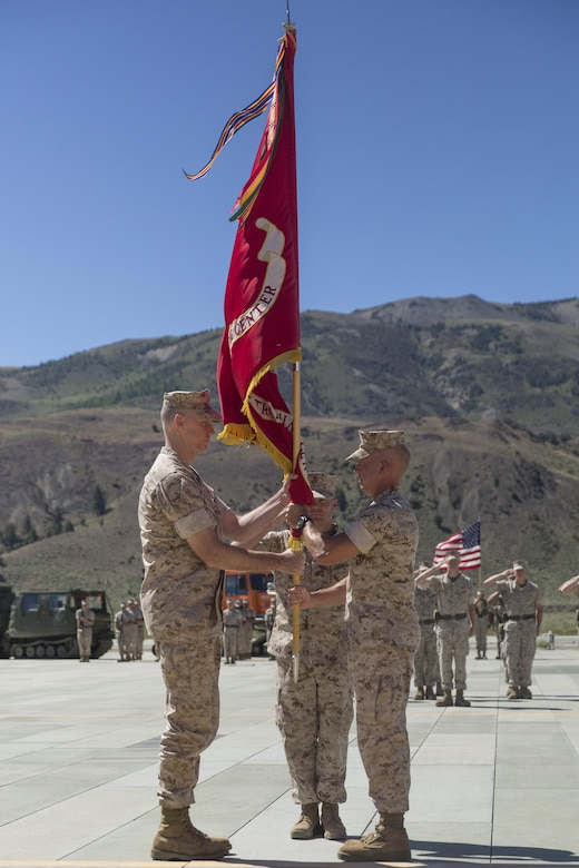 Colonel Scott D. Leonard, outgoing commanding officer, Marine Corps Mountain Warfare Training Center, relinquishes command to Col. James E. Donnellan, oncoming commanding officer, MCMWTC, during the change of command ceremony at the expeditionary airfield, July 22, 2016. (Official Marine Corps photo by Cpl. Medina Ayala-Lo/Released)