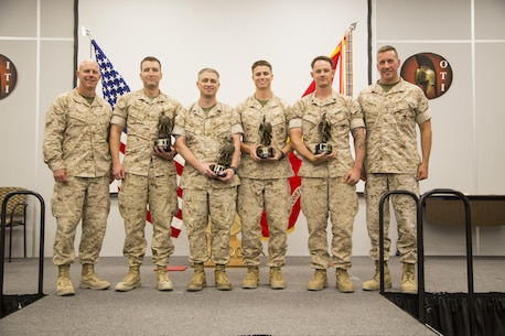 The honor graduates of Tactical Marine Air Ground Task Force Integration Course 2-16 present their awards during the graduation ceremony aboard the Marine Corps Air Ground Combat Center, Twentynine Palms, Calif., July 23, 2016. (Official Marine Corps photo by Lance Cpl. Alysa Jesse/Released)