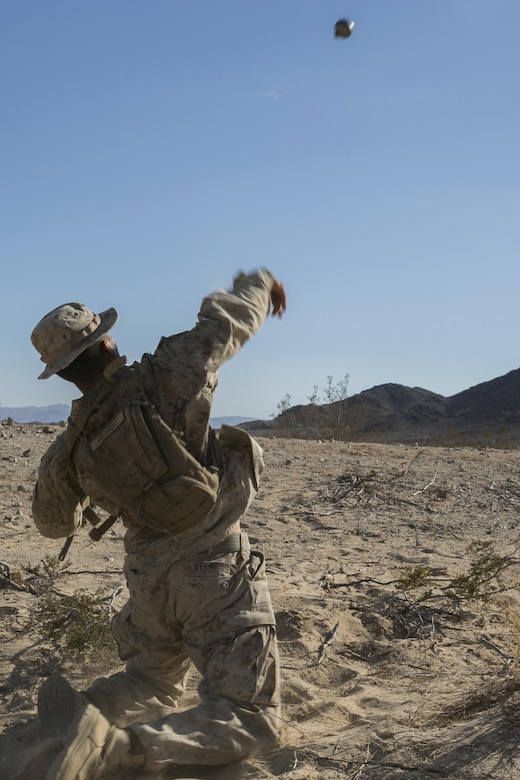 "Pfc. Jurel Velardo, team leader, 3rd Battalion, 4th Marines, 7th Marine Regiment, throws an inert fragmentation grenade during a non-live-fire exercise as part of Tactical Small-Unit Leadership Course aboard Marine Corps Air Ground Combat Center, Twentynine Palms, Calif., July 17, 2016. The purpose of the course was to focus on the training of small-unit leadership within ""Darkside."" (Official Marine Corps photo by Lance Cpl. Dave Flores/Released)"