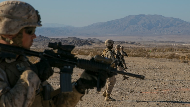 "Marines with 3rd Battalion, 4th Marines, 7th Marine Regiment, proceed in a skirmisher formation at the beginning of a live-fire exercise as part of Tactical Small-Unit Leadership Course aboard Marine Corps Air Ground Combat Center, Twentynine Palms, Calif., July 18, 2016. The purpose of the course was to focus on the training of small-unit leadership within ""Darkside."" (Official Marine Corps photo by Lance Cpl. Dave Flores/Released)"
