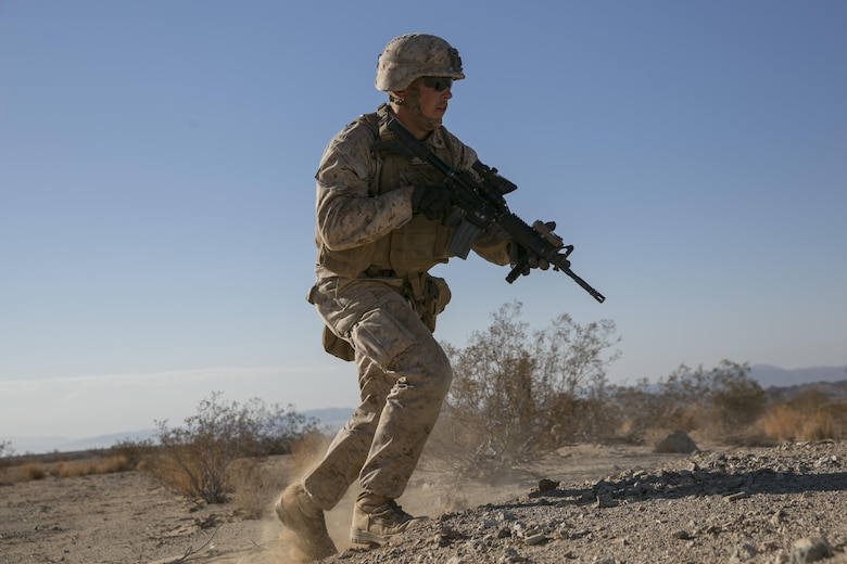 "Cpl. Reid Ohala, team leader, 3rd Battalion, 4th Marines, 7th Marine Regiment, advances during a live-fire exercise as part of Tactical Small-Unit Leadership Course aboard Marine Corps Air Ground Combat Center, Twentynine Palms, Calif., July 18, 2016. The purpose of the course was to focus on the training of small-unit leadership within ""Darkside."" (Official Marine Corps photo by Lance Cpl. Dave Flores/Released)"