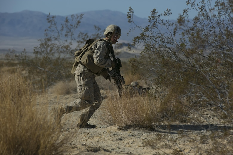 "Cpl. Shane Martin, team leader, 3rd Battalion, 4th Marines, 7th Marine Regiment, advances during a fire team live-fire exercise as part of Tactical Small-Unit Leadership Course aboard Marine Corps Air Ground Combat Center, Calif. July 18, 2016. The purpose of the course was to focus on the training of small-unit leadership within ""Darkside."" (Official Marine Corps photo by Lance Cpl. Dave Flores/Released)"