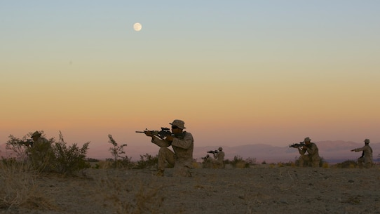 "A squad of Marines with 3rd Battalion, 4th Marines, 7th Marine Regiment, practice dry runs before their night time live-fire exercises as part of Tactical Small-Unit Leadership Course aboard Marine Corps Air Ground Combat Center, Twentynine Palms, Calif., July 18, 2016. The purpose of the course was to focus on the training of small-unit leadership within ""Darkside."" (Official Marine Corps photo by Lance Cpl. Dave Flores/Released)"