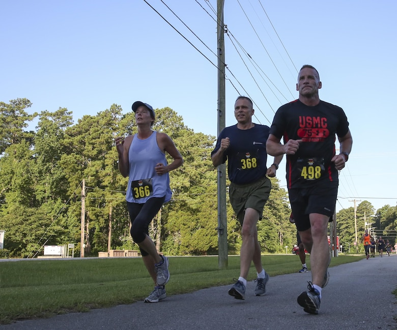 (Left to Right) Francine Glavy, Brig. Gen. Matthew Glavy and Sgt. Maj. Richard Thresher run to the finish line during the 7.5K Anniversary Run aboard Marine Corps Air Station Cherry Point, N.C., July 29, 2016. The run was to celebrate the 75th anniversary of MCAS Cherry Point and 2nd Marine Aircraft Wing. Thresher is the sergeant major and Glavy is the commanding general of 2nd MAW. (Marine Corps photo by Lance Cpl. Cody Lemons/ Released)