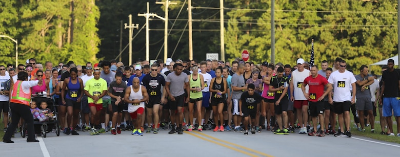 Runners prepare to start the 7.5K Anniversary Run aboard Marine Corps Air Station Cherry Point, N.C., July 29, 2016. The run was to celebrate the 75th anniversary of MCAS Cherry Point and 2nd Marine Aircraft Wing. (Marine Corps photo by Lance Cpl. Cody Lemons/ Released)