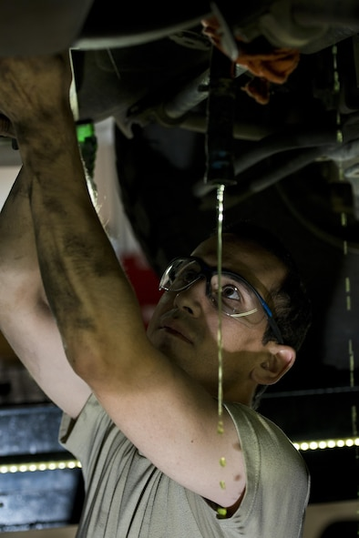 Staff Sgt. Adam Garcia, 5th Logistics Readiness Squadron vehicle maintenance technician, drains fluid from a Humvee in the Defender Dome at Minot Air Force Base, N.D., July 28, 2016. Airmen from the 5th LRS vehicle maintenance flight work to ensure that Team Minot stays mobile. (U.S. Air Force photos/Airman 1st Class J.T. Armstrong)