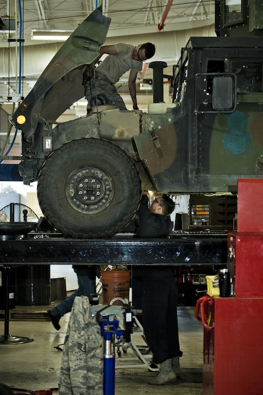 Airmen from the 5th Logistics Readiness Squadron maintain a Humvee in the Defender Dome at Minot Air Force Base, N.D., July 28, 2016. The 91st Security Support Squadron is specifically responsible for preventative maintenance inspections and troubleshooting, and everything from electrical repair to transmission replacement, on armored Humvees and Bearcats. (U.S. Air Force photos/Airman 1st Class J.T. Armstrong)