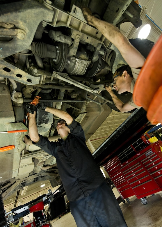 Senior Airman Logan Rivelli (left) and Staff Sgt. Adam Garcia, 5th Logistics Readiness Squadron vehicle maintenance technicians, inspect the underside of a Humvee in the Defender Dome at Minot Air Force Base, N.D., July 28, 2016. Airmen from the 5th LRS vehicle maintenance flight work to ensure that Team Minot stays mobile. (U.S. Air Force photos/Airman 1st Class J.T. Armstrong)