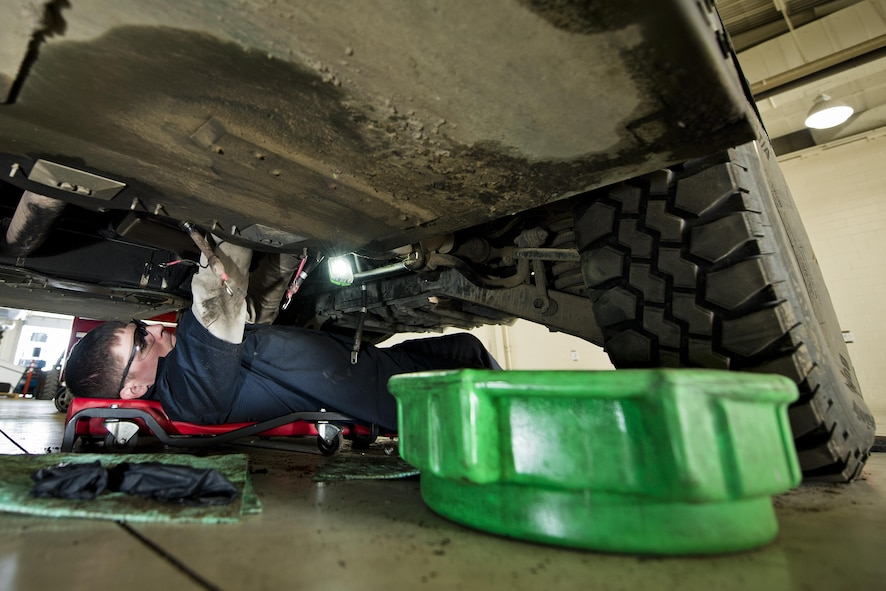 Senior Airman Brad Agner, 5th Logistics Readiness Squadron vehicle maintenance technician, works underneath a Humvee in the Defender Dome at Minot Air Force Base, N.D., July 28, 2016. Airmen from the 5th LRS vehicle maintenance flight work to ensure that Team Minot stays mobile. (U.S. Air Force photos/Airman 1st Class J.T. Armstrong)
