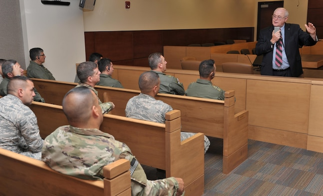Judge Patt Maney, the county judge for Okaloosa County Court of Florida, explains the U.S. justice system to Building Partnership Aviation Capacity Seminar attendees at Ft. Walton Beach, Fla.,July 19, 2016. BPACS is a two-week long event, held four times a year, which brings aviation-minded foreign military personnel together with U.S. civilains and military membbers to learn about aviation enterprise and security. (U.S. Air Force photo by Staff Sgt. Kentavist P. Brackin)