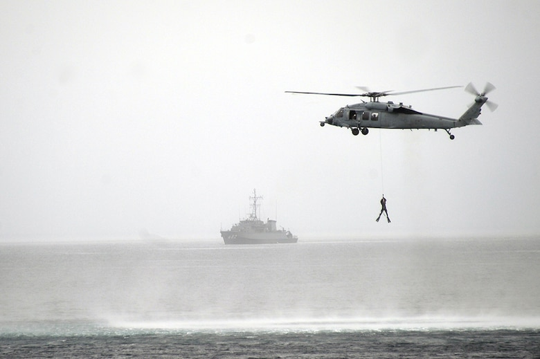 (July 20, 2016) - An SH-60S helicopter assigned to Helicopter Sea Combat Squadron (HSC) 25, recovers a member of the Japan Maritime Self-Defense Force (JMSDF) explosive ordnance disposal unit from Mutsu Bay off the coast of Japan during the 2JA 2016 Mine Countermeasures Exercise (2JA-16 MCMEX), July 20, 2016. 2JA Mine Countermeasures Exercise is an annual bilateral exercise held between the U.S. Navy and JMSDF to strengthen interoperability and increase proficiencies in mine countermeasure operations.