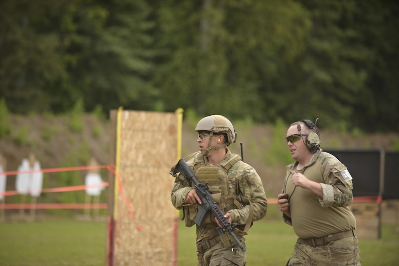 U.S. Air Force Senior Airman Isaac Heustess, a 3rd Air Support Operations Squadron, Joint-Base Elmendorf-Richardson, Alaska, tactical air control party specialist, runs through the stress shooting course as part of Cascade Challenge July 20, 2016, at a practice range in Delta Junction, Alaska. Competitors had to perform maneuvers with the distraction of ambient blank cartridge blasts, simulating the stress of a live combat engagement. (U.S. Air Force photo by Airman Isaac Johnson)