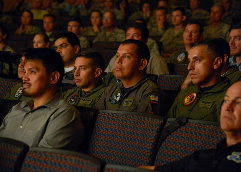 Service members from twelve different nations gather together for a briefing on the upcoming PANAMAX exercise at the base theater on Davis-Monthan AFB, Ariz., July 26, 2016. Nineteen total nations are joining the United States for a seven-day exercise that will use simulations to command and control multinational notional sea, air, cyber and land forces defending the vital waterway and surrounding areas against threats from violent extremism and to provide for humanitarian relief, as necessary. The PANAMAX exercise goal is to increase the ability of nations to work together, enable assembled forces to organize as a multination task force and test their responsiveness in combined operations. (U.S. Air Force photo by Tech. Sgt. Heather R. Redman)