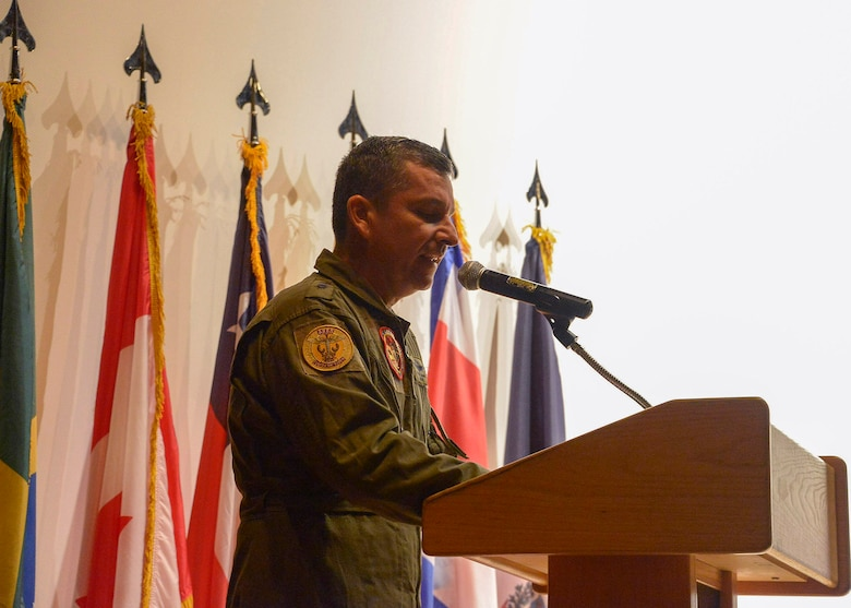 Colombian air force Brig. Gen. Sergio Andrés Garzón Vélez, PAMAMAX Combined Forces Air Component Commander, explains his expectations to the air forces participants for the upcoming PANAMAX Exercise at the base theater on Davis-Monthan AFB, Ariz., July 26, 2016. Nineteen total nations are joining the United States for a seven-day exercise that will use simulations to command and control multinational notional sea, air, cyber and land forces defending the vital waterway and surrounding areas against threats from violent extremism and to provide for humanitarian relief, as necessary. The PANAMAX exercise goal is to increase the ability of nations to work together, enable assembled forces to organize as a multination task force and test their responsiveness in combined operations. (U.S. Air Force photo by Tech. Sgt. Heather R. Redman)