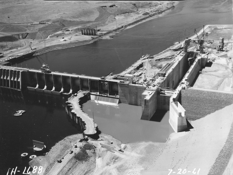 Ice Harbor Lock and Dam upstream of the Tri-Cities on the Lower Snake River celebrated its 50th anniversary of construction by the U.S. Army Corps of Engineers, June 16, 2012 at the dam. It was built from 1956 to 1962 and dedicated by Vice-President Lyndon B. Johnson on May 9, 1962. Corps of Engineers photos. (Looking downstream, lock and spillway)