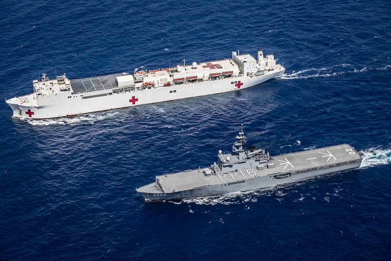 JS Shimokita (LST-4002) steams alongside hospital ship USNS Mercy (T-AH 19) while transiting to the third mission stop of Pacific Partnership 2016 in Da Nang, Vietnam. Upon arrival, partner nations will work side-by-side with local military and non-government organizations to conduct cooperative health engagements, community relation events and subject matter expert exchanges to better prepare for a natural disaster or crisis.