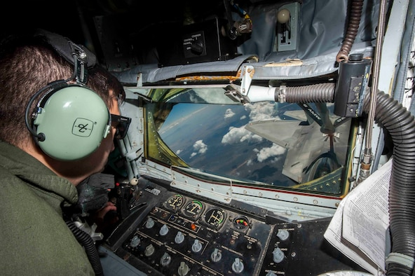 Senior Airman Eric Medina, 92nd Air Refueling Squadron boom operator, Fairchild Air Force Base, Wash., refuels an F-22 Raptor from Joint Base Langley-Eustis, Va., in a training sortie during Red Flag 16-3, July 21, 2016. During Red Flag, Medina is in charge of refueling aircraft that are participating in the exercise so they can continue the fight without having to return to Nellis AFB, Nev., for fuel. (U.S. Air Force photo by Senior Airman Jake Carter/Released)