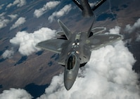 An F-22 Raptor, from Joint Base Langley-Eustis, Va., banks off after receiving fuel from a KC-135 Stratotanker over the Nevada Test and Training Range in a training sortie during Red Flag 16-3, July 21, 2016. During Red Flag 16-3, units from the U.S. Air Force, Marine Corps and Navy will work together to succeed in air, space and cyberspace. (U.S. Air Force photo by Senior Airman Jake Carter/Released)