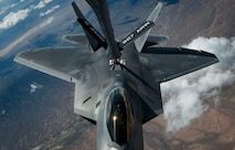 An F-22 Raptor, from Joint Base Langley-Eustis, Va., receives fuel from a KC-135 Stratotanker over the Nevada Test and Training Range in a training sortie during Red Flag 16-3, July 21, 2016. Red Flag, which is conducted by the 414th Combat Training Squadron at Nellis AFB, is a realistic combat training exercise involving the air forces of the U.S. and its allies that maximizes the combat readiness and survivability of participants by providing a realistic training environment. (U.S. Air Force photo by Senior Airman Jake Carter/Released)