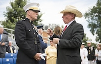 Marine Corps Gen. Joe. Dunford, left, chairman of the Joint Chiefs of Staff, speaks with retired Marine Corps Sgt. Maj. Harold G. Overstreet, a former sergeant major of the Marine Corps, before a naming ceremony for the USS Harvey C. Barnum Jr. at Marine Barracks Washington, D.C., July 28, 2016. Barnum, a Vietnam War veteran and Medal of Honor recipient, also attended the ceremony to name the ship, which will be an Arleigh Burke-class guided-missile destroyer. DoD photo by Army Sgt. James K. McCann