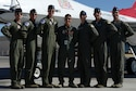 U.S. Air Force Air Demonstration Squadron pilots one through six pose for a photo with Reymond during his visit to Nellis Air Force Base, Nev., July 19, 2016. The first part of his day was spent with the Thunderbirds team members where he got to partake in their launch and recovery. (U.S. Air Force photo by Senior Airman Tabatha McCarthy)