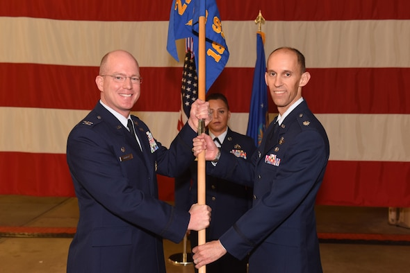 Col. Troy Endicott, 21st Operations Group commander, assigns command of the 18th Space Control Squadron to Lt. Col. Scott Putnam, 18th SPCS commander, during an assumption of command ceremony, July 22, 2016, Vandenberg Air Force Base, Calif. Putnam assumed command of the 18th SPCS, the newest space surveillance unit that will fall under the 21st Space Wing.