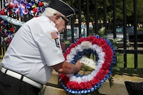 A Korean War veteran prepares a wreath during the National Korean War Veterans Armistice Day event at the New Jersey Korean Veterans War Memorial in Brighton Park, Atlantic City, N.J., July 27, 2016. On July 27, 1953, leaders signed the Korean Armistice Agreement to end the conflict. Air National Guard photo by Tech. Sgt. Matt Hecht