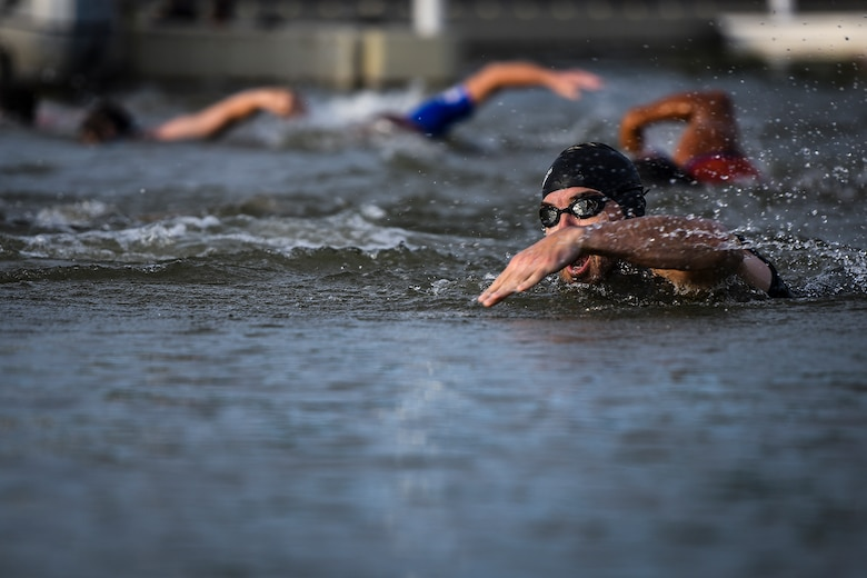 A swimmer makes a front crawl stroke during the Goodfellow Air Force Base Triathlon at the Goodfellow Recreation Camp in San Angelo, Texas, July 30, 2016. Civilians and military service members competed in the race which began with a 400-meter swim. (U.S. Air Force photo by Senior Airman Devin Boyer/Released)
