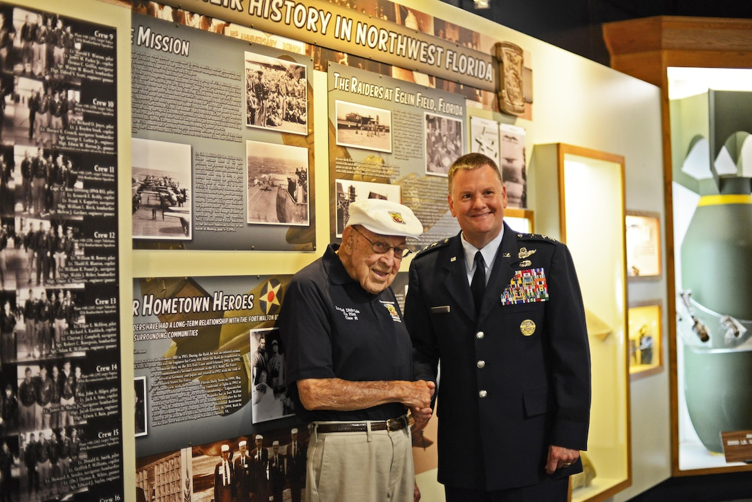 "Lt. Col. (ret.) Richard ""Dick"" Cole greets Lt. Gen. Brad Webb, commander of Air Force Special Operations Command at the Doolittle Raider's exhibit July 30, 2016 at the U.S. Air Force Armament Museum on Eglin Air Force Base, Fla. Webb spoke at the ceremony and highlighted the importance of Cole and his history as one of the founding members of the 1st Air Commando Group. (U.S. Air Force photo/Staff Sgt. Melanie Holochwost)"
