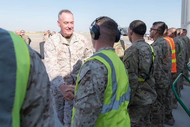 Marine Corps Gen. Joe Dunford, chairman of the Joint Chiefs of Staff, speaks with service members after arriving in Baghdad, July 30, 2016. DoD photo by Navy Petty Officer 2nd Class Dominique A. Pineiro