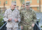 Marine Corps Gen. Joe Dunford, chairman of the Joint Chiefs of Staff, talks with Army Lt. Gen. Sean MacFarland, commander of Combined Joint Task Force-Operation Inherent Resolve, at the U.S. Embassy in Baghdad, July 30, 2016. DoD photo by Navy Petty Officer 2nd Class Dominique A. Pineiro