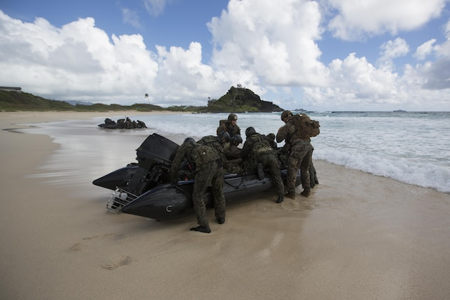 Japanese reconnaissance soldiers and U.S. Marines with 5th Air Naval Gunfire Liaison Company assault a beach during Rim of the Pacific 2016.  The assault was launched from USS San Diego and commanded by III Marine Expeditionary Force units aboard USS America.  Twenty-six nations, more than 40 ships and submarines, more than 200 aircraft and 25,000 personnel are participating in RIMPAC from June 30 to Aug. 4, in and around the Hawaiian Islands and Southern California. The world's largest international maritime exercise, RIMPAC provides a unique training opportunity that helps participants foster and sustain the cooperative relationships that are critical to ensuring the safety of sea lanes and security in the world's oceans. RIMPAC 2016 is the 25th exercise in the series that began in 1971. (U.S. Marine Corps photo by Lance Cpl. Matthew Casbarro/Released)