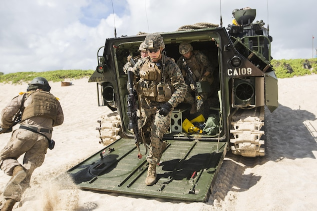U.S. Marines with Company E, Battalion Landing Team 2nd Battalion, 3rd Marine Regiment, exit an Assault Amphibious Vehicle to assault a beach during Rim of the Pacific 2016. The assault was launched from USS San Diego and commanded by III Marine Expeditionary Force units aboard USS America.Twenty-six nations, more than 40 ships and submarines, more than 200 aircraft and 25,000 personnel are participating in RIMPAC from June 30 to Aug. 4, in and around the Hawaiian Islands and Southern California. The world's largest international maritime exercise, RIMPAC provides a unique training opportunity that helps participants foster and sustain the cooperative relationships that are critical to ensuring the safety of sea lanes and security in the world's oceans. RIMPAC 2016 is the 25th exercise in the series that began in 1971. (U.S. Marine Corps photo by Lance Cpl. Matthew Casbarro)