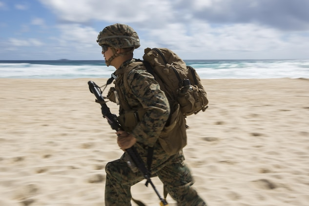 160730-M-GA922-1025 MARINE CORPS BASE, HAWAII (July 30, 2016) - A U.S. Marine with Company E, Battalion Landing Team 2nd Battalion, 3rd Marine Regiment, assaults a beach during Rim of the Pacific 2016. Twenty-six nations, more than 40 ships and submarines, more than 200 aircraft and 25,000 personnel are participating in RIMPAC from June 30 to Aug. 4, in and around the Hawaiian Islands and Southern California. The world's largest international maritime exercise, RIMPAC provides a unique training opportunity that helps participants foster and sustain the cooperative relationships that are critical to ensuring the safety of sea lanes and security in the world's oceans. RIMPAC 2016 is the 25th exercise in the series that began in 1971. (U.S. Marine Corps photo by Lance Cpl. Matthew Casbarro/Released)