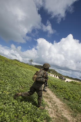 160730-M-GA922-1038 MARINE CORPS BASE, HAWAII (July 30, 2016) - A U.S. Marine with Company E, Battalion Landing Team 2nd Battalion, 3rd Marine Regiment, assaults a beach during Rim of the Pacific 2016. Twenty-six nations, more than 40 ships and submarines, more than 200 aircraft and 25,000 personnel are participating in RIMPAC from June 30 to Aug. 4, in and around the Hawaiian Islands and Southern California. The world's largest international maritime exercise, RIMPAC provides a unique training opportunity that helps participants foster and sustain the cooperative relationships that are critical to ensuring the safety of sea lanes and security in the world's oceans. RIMPAC 2016 is the 25th exercise in the series that began in 1971. (U.S. Marine Corps photo by Lance Cpl. Matthew Casbarro)