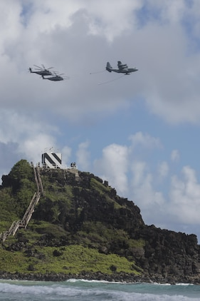 160730-M-GA922-1097 MARINE CORPS BASE, HAWAII (July 30, 2016) - A U.S. Marine Corps KC-130J Hercules and two CH-53E Super Stallions conduct a refueling exercise during Rim of the Pacific 2016. Twenty-six nations, more than 40 ships and submarines, more than 200 aircraft and 25,000 personnel are participating in RIMPAC from June 30 to Aug. 4, in and around the Hawaiian Islands and Southern California. The world's largest international maritime exercise, RIMPAC provides a unique training opportunity that helps participants foster and sustain the cooperative relationships that are critical to ensuring the safety of sea lanes and security in the world's oceans. RIMPAC 2016 is the 25th exercise in the series that began in 1971. (U.S. Marine Corps photo by Lance Cpl. Matthew Casbarro)