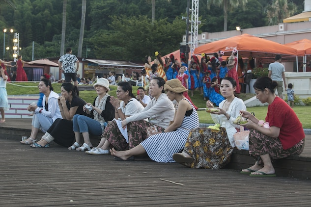 Japanese locals enjoy some of the foods served at the U.S. – Japan Luau Party on Oshima Island, Japan, July 23, 2016. Residents of Marine Corps Air Station Iwakuni visited the island of Oshima to join in celebration of the island's history and the bond between the U.S. and Japan. (U.S. Marine Corps photo by Cpl. Nathan Wicks)
