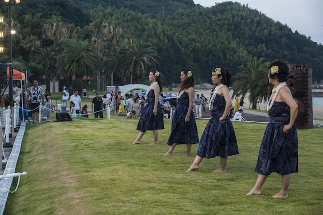 Hula dancers prepare to kick-off their performance during the U.S. – Japan Luau Party on Oshima Island, Japan, July 23, 2016. Residents of Marine Corps Air Station Iwakuni visited the island of Oshima to join in celebration of the island's history and the bond between the U.S. and Japan. (U.S. Marine Corps photo by Cpl. Nathan Wicks)