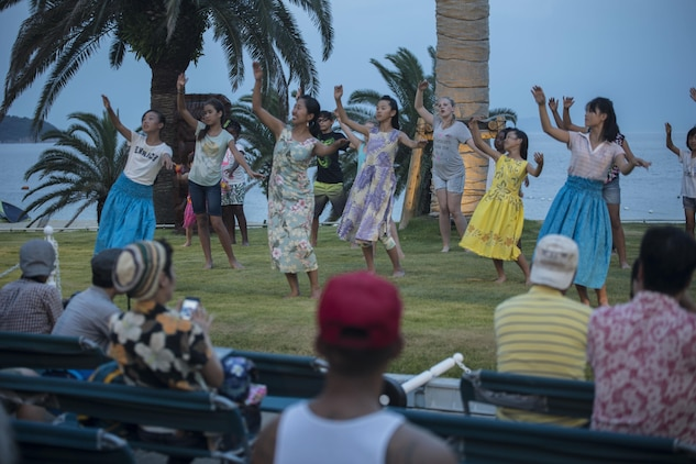 Residents of Marine Corps Air Station Iwakuni participate in the Hawaiian festivities by hula dancing during the U.S. – Japan Luau Party on Oshima Island, Japan, July 23, 2016. Residents of Marine Corps Air Station Iwakuni visited the island of Oshima to join in celebration of the island's history and the bond between the U.S. and Japan. (U.S. Marine Corps photo by Cpl. Nathan Wicks)