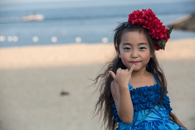 An Oshima Island child and participant in the hula dancing during the U.S. – Japan Luau Party poses for a picture on Oshima Island, Japan, July 23, 2016. Residents of Marine Corps Air Station Iwakuni visited the island of Oshima to join in celebration of the island's history and the bond between the U.S. and Japan. (U.S. Marine Corps photo by Cpl. Nathan Wicks)