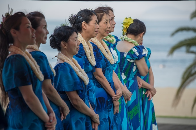 Hula dancers wait for their turn to perform during the U.S. – Japan Luau Party on Oshima Island, Japan, July 23, 2016. Residents of Marine Corps Air Station Iwakuni visited the island of Oshima to join in celebration of the island's history and the bond between the U.S. and Japan. (U.S. Marine Corps photo by Cpl. Nathan Wicks)