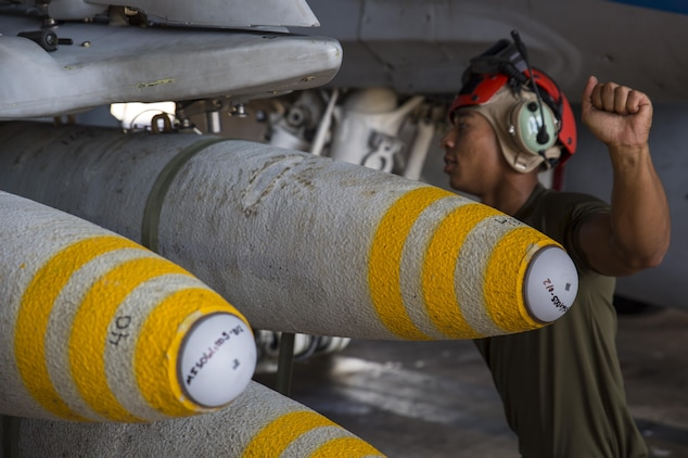 Cpl. Javon Franklin, an aviation ordnance technician with Marine Fighter Attack Squadron (VMFA) 122, assists in loading high explosive ordnance on an F/A-18C Hornet during exercise Southern Frontier at Royal Australian Air Force Base Tindal, Australia, July 28, 2016. Southern Frontier is three weeks of unit level training helping the squadron gain experience and qualifications in low altitude, air-ground, high explosive ordnance delivery at the unit level. VMFA-122 is home based out of Marine Corps Air Station Beaufort, South Carolina and are currently assigned to MAG-12 at MCAS Iwakuni under the Unit Deployment Program.  Australia is the last stop on the squadron's deployment before heading back home.   (U.S. Marine Corps photo by Cpl. Nicole Zurbrugg)