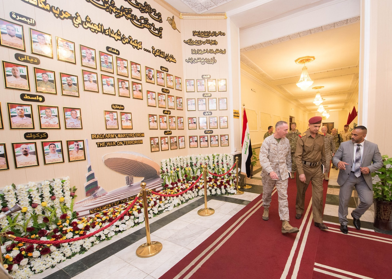 Marine Corps Gen. Joe Dunford, chairman of the Joint Chiefs of Staff, departs the Iraqi Ministry of Defense with Iraqi chief of defense Lt. Gen. Othman al-Ghanimi in Baghdad, July 31, 2016. Iraqi security forces and the Kurdish Peshmerga are working with the coalition to plan an upcoming offensive to retake Mosul, Iraq, from the Islamic State of Iraq and the Levant. DoD Photo by Navy Petty Officer 2nd Class Dominique A. Pineiro