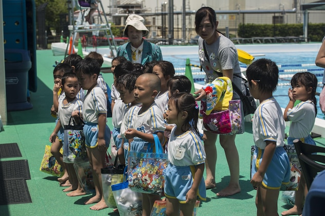 Students of Iwakuni-Kawashimo Kindergarten listen to a safety during a school visit at Marine Corps Air Station Iwakuni, Japan, July 21, 2016. The school visit is a time honored tradition between the base and the local community and holds a lasting memory with the visiting students. (U.S. Marine Corps photo by Cpl. Nathan Wicks)