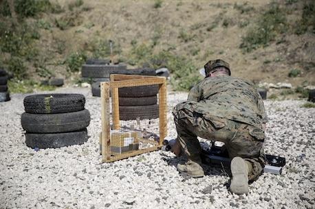 Sgt. Perry Robinson, an explosive ordnance disposal technician, prepares an energetic tool during a counter-improvised explosive device range near Naval Air Station Sigonella, Italy, May 24, 2016.  EOD Marines with Special Purpose Marine Air-Ground Task Force Crisis Response-Africa used precision energetic tools to safely render an IED useless.  (U.S. Marine Corps photo by Cpl. Alexander Mitchell/released)