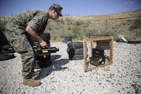Sgt. Alex Micciche, an explosive ordnance disposal technician, prepares to use an energetic tool during a counter-improvised explosive device range near Naval Air Station Sigonella, Italy, May 24, 2016.  EOD Marines with Special Purpose Marine Air-Ground Task Force Crisis Response-Africa used precision energetic tools to safely render an IED useless.  (U.S. Marine Corps photo by Cpl. Alexander Mitchell/released)