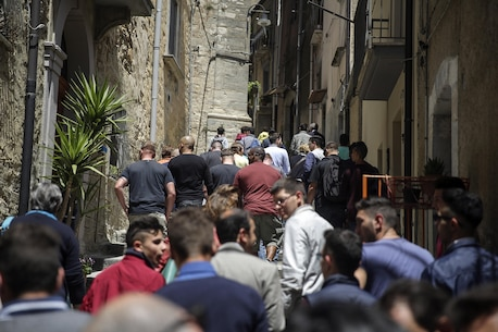 "Marines and sailors with Special Purpose Marine Air-Ground Task Force Crisis Response-Africa, walk up a narrow alleyway during a community project in Nicosia, Italy, May 25, 2016.  Students from Instituto di Istruzione Superiore ""Alessandro Volta"" were able to practice their English and share their culture while leading Marines and sailors on a tour around Nicosia. (U.S. Marine Corps photo by Cpl. Alexander Mitchell/released)"